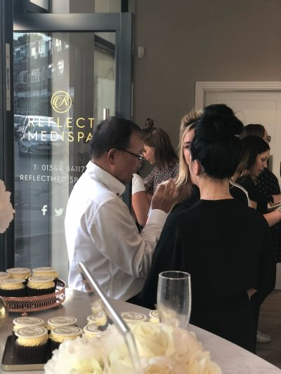 People enjoying the relaunch party at Reflect MediSpa in Virginia Water