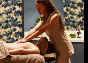 A guest enjoys a massage