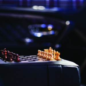 The bespoke The Mulliner wooden chessboard in the rear seat rest