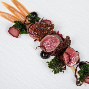 The winter feast includes dishes like roast loin of venison