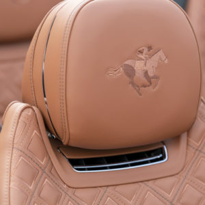 Horse and rider silhouettes adorn all four seats, that are finished in the aptly named sustainable Saddle hide