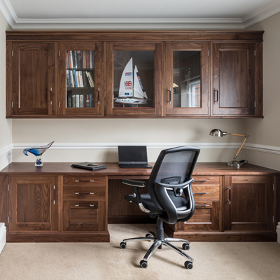 Wood is always a sound choice for office furniture - such as this warm, rich walnut design by Rencraft