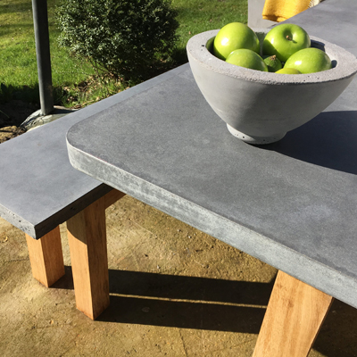 An outdoor table and rectangular bench in concrete