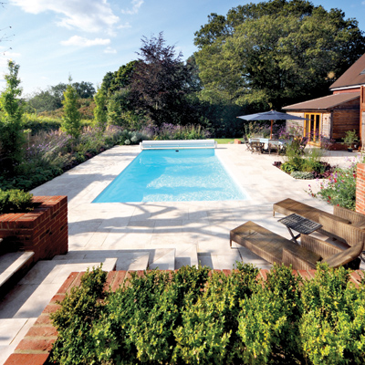 Contemporary Town Garden, Haslemere, Surrey] Swimming Pool, garden design, lime stone paving by Graduate Landscapes