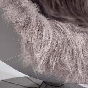 The Igloo Pod swivel globe chair has long-haired Icelandic sheepskin and padded seating