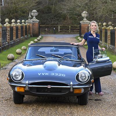 Laura Hamilton models alongside a Series 2 E-Type Jaguar