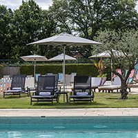 An outdoor pool is complemented by indoor spa facilities at The Grove