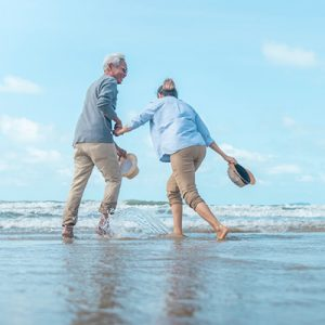 Mature couple enjoying each other's company on the beach