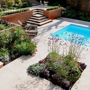 Contemporary Town Garden, Haslemere, Surrey, Swimming Pool; garden design with lime stone paving by Graduate landscapes