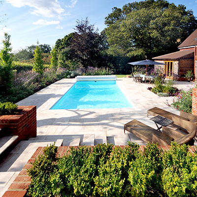 Contemporary Town Garden, Haslemere, Surrey - Swimming Pool, garden design, lime stone paving by Graduate landscapes